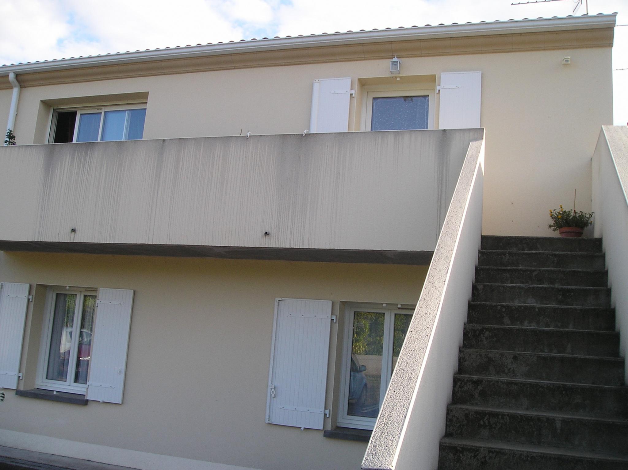 accès appartement arrière immeuble